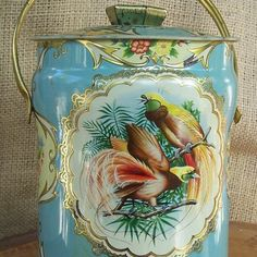 Vintage Tin.. Look at the beautiful illustration of Papua Bird of Paradise (Cendrawasih)!