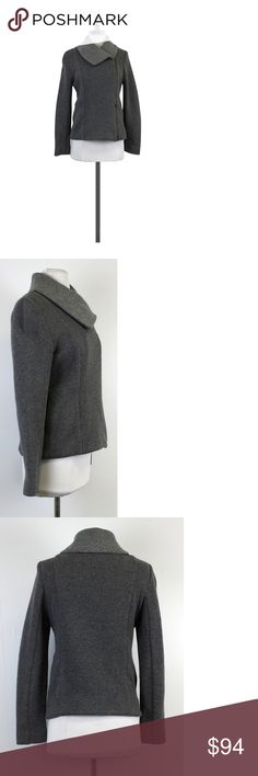 "Theory- Grey Wool Zip Up Sweater Jacket Sz M With its off-center zip & oversized collar, this grey sweater jacket provides subtle style to a simple look. Functional hip pockets provide added comfort. Size M Shell 65% wool 30% nylon 5% other fibers Lining 100% polyester Shoulder to hem 22"" Simple yet so classic, Theory pieces are some of the best to accessorize with simple, elegant, form that flatter any body type along with solid colors sometimes broken up in strategic ways to flatter the…"