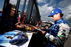 Jeff Gordon Photos - Jeff Gordon, driver of the #88 Nationwide Chevrolet, signs autographs during qualifying for the NASCAR Sprint Cup Series Pennsylvania 400 at Pocono Raceway on July 29, 2016 in Long Pond, Pennsylvania. - Pocono Raceway - Day 1