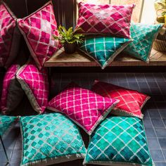 Our stunning collection of Phulkari Cushions offer tonal shades of fuchsia, pink and turquoise that will brighten your interior for the summer months. In a striking geometric design, these square and rectangular cushions will decorate your favourite armch Pink Cushions, Velvet Cushions, Minimalist Cushions, Spirit Of Summer, Sequin Cushion, Cloud Cushion, Iron Chandeliers, Color Correction, Color Splash