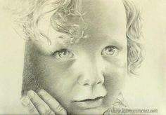Portrait au fusain et mine graphite.  Portrait dessin d'enfant réalisé d'après photo sur papier dessin blanc.