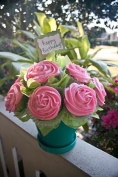 Cupcake bouquet with extra liner and green tissue paper filling in spaces