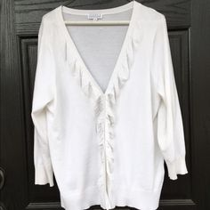 White button up ruffle cardigan In excellent condition! Gorgeous and soft white V neck button down top which gathers and ruffles at the buttons. 3/4 sleeves. Ribbing at the wrists and hem. Feels like cashmere. Measures 23 inches from shoulder to hem. Thanks for looking.💕 Joseph A.  Sweaters Cardigans