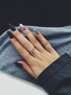 Matte black and silver (?) glitter nails. Love the contrast and finer size of the glitter. Very clean.