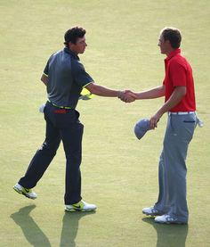 Rory McIlroy of Northern Ireland shakes hands with Jordan Spieth of the United States on the 18th green during the second round of The 143rd Open Championship at Royal Liverpool on July 18, 2014 in Hoylake, England.