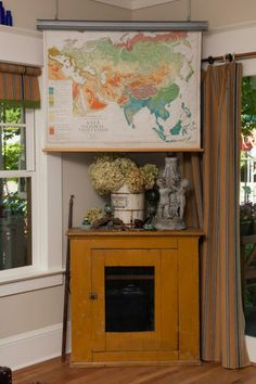 old pull down schoolroom map or pull down art on canvas to hide flat screen tv eclectic living room by whitney lyons - Flat Panel Dining Room Decorating