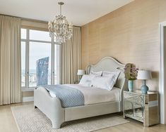 A neutral palette with touches of soft blue fill the master bedroom suite. Bedding by Matouk.
