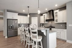 Willow home kitchen with gray granite and matte backsplash