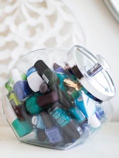 This is cute and effective! Use a clear cookie jar to organize nail polish plus 13 Gorgeous Tidy Tips and Organization Hacks