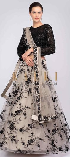 Taupe grey net lehenga with satin under layer. The lehenga is adorn with black floral jaal embroidery along with resham and sequins detailing. Lehenga Crop Top, Black Lehenga, Floral Lehenga, Net Lehenga, Bridal Lehenga Choli, Indian Lehenga, Choli Designs, Lehenga Designs, Indian Dresses