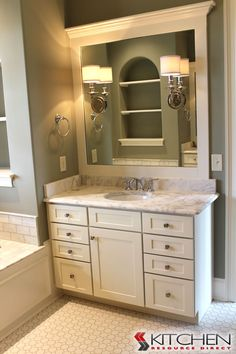 Lovely Vanity With White Cabinets And Marble Top; Matching Framed Mirror Cabinets  Featured Are Titusville RTA