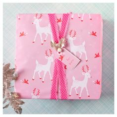 amazing pink and white reindeer wrapping paper with pink polka dotted ribbon!