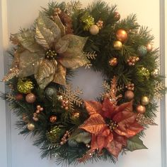 Artificial evergreen wreath decorated with green and bronze poinsettias and matching ornaments, berries and gold snowflakes Diy Christmas Presents, Christmas Door Wreaths, Christmas Swags, Outdoor Christmas Decorations, Holiday Wreaths, Christmas Time, Christmas Crafts, Christmas Ornaments, Christmas Arrangements
