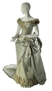 The ice-blue ball gown c 1886 includes many of the features that make Worth gowns so special. Masterful draping, an eye-catching combination of fabrics (including uncut velvet, satin, chiffon, glass beads, lace, & silk plush!) that create an interplay of textures, and dramatic asymmetry all help create a gown that would make the wearer stand out even in the most crowded ball.