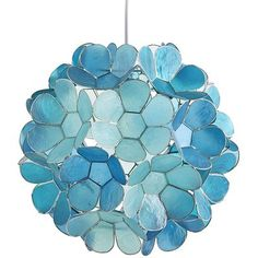 Symbolizing purity while providing pure brilliance, our Daisy Capiz Pendant Light is a shimmering natural. The source of its beautiful blue glow? Capiz shells painted aqua and teal then hand-formed into floral blooms. You know where to hang it—over your d Hanging Patio Lights, Patio Lighting, Home Lighting, Lighting Ideas, Lighting Design, Hanging Lamps, Bathroom Lighting, Beach Lighting, Coastal Lighting