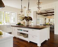 This transitional kitchen has a very interesting design. Love the island.