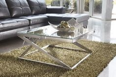 When it comes to clean lines and modern style the square Coylin Coffee Table has come full circle.