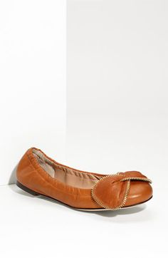 Free shipping and returns on See by Chloé Leather Flat at Nordstrom.com. Brassy zipper teeth outline the bow that tops a soft leather flat with an elasticized collar.