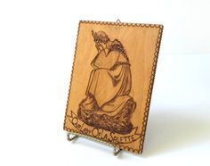 "This beautiful piece of pyrography art, ""Our Lady of La Salette,"" is a vintage wood-burned plaque with the weeping Blessed Virgin Mary."