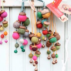 """A collection of 3 bright fuzzy acorn holiday ornaments for your Christmas tree. A sweet little gift to charm the hostess, decorate a whole tree for the holidays, top a package, a cat toy perhaps? Lets face it, all ornaments are cat toys. As selected for the Down East magazine Maine-made gift guide. Eco friendly graduated acorn caps all hand collected, dried and embellished with vibrant colors of Fair Trade wool felt and cord, about 6"""" long. Each fuzzy bead is thoughtfully selected for color…"""