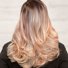 Here's what happens when the strobing technique and fashion colors make sweet love and have a gorgeous baby—color strobing! The mother of hair artistry Alix Clymer (aka @alix_maya, founder of @theunicorntribe) gives us this look, which combines delicate pops of pewter and plumeria grounded in a pretty blonde base.