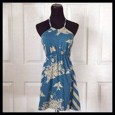 """{Heritage 1981} Blue Dress Material & Care: • Cotton • Machine wash  Measurements (approx. laying flat): • Bust (underarm to underarm) - 12""""-21"""" • Waist - 9""""-20"""" • Length (mid front to hem) - 27""""  Extras: • Adjustable strap  Condition: • Pre-loved in good condition • History unknown (bought from another seller) • No rips or stains  Warning: • Small hole (pictured)  No Trades • Bundle for discounts! • All reasonable offers considered! Heritage 1981 Dresses"""