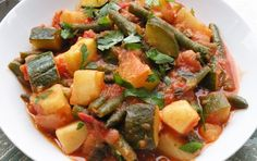 Greek Stewed Potatoes, Tomatoes, and Zucchini.Here's a simple Greek-inspired stew bursting with summer flavors — tomatoes and zucchini in a mellow base of potatoes. A fresh, crusty bread is a must with this. Greek Potatoes, Green Beans And Potatoes, Stewed Potatoes, Greek Recipes, Real Food Recipes, Soup Recipes, Vegan Recipes, Peasant Food, Vegan Stew
