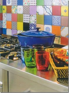 Colorful Backsplash...could get the same effect by decoupaging scrap book paper on existing boring tiles.What a great idea.