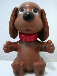 Rub-a-Dub Doggy! It's a bath toy. His ears would get wet, you pull a string, and he shakes his head.