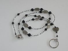 Hey, I found this really awesome Etsy listing at https://www.etsy.com/listing/473150019/black-and-silver-breakaway-lanyard-with