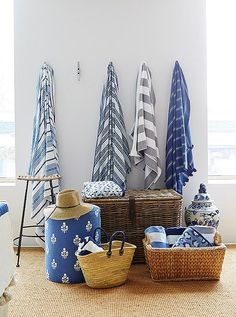 A collection of blue and white striped beach towels makes a fun summer display.