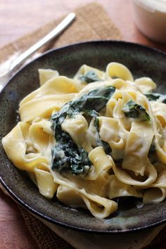 pappardelle with kale and creamy cauliflower parmesan garlic sauce