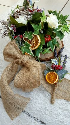 Perfect for a Christmas wedding. Bridal bouquet and matching buttonhole, filled with dried citrus fruits and frosty holly leaves.  https://www.etsy.com/uk/listing/462305042/rustic-winter-wedding-bouquet-with