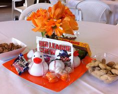 Centerpieces for SF Giants theme baby shower.  Baseball ducks from Michaels. Peanuts and cinnamon sugared walnuts just like they sell at AT & T Park.