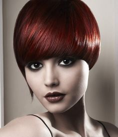 A short red straight coloured multi-tonal bob haircut womens modern hairstyle by Zullo and Holland