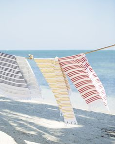 Pinstriped Fouta beach towel: http://www.stylemepretty.com/living/2016/05/29/20-trendy-beach-towels-that-will-have-you-sitting-pretty-this-summer/