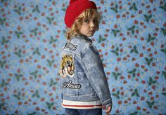 Patches on denim in the new Gucci children's collection.