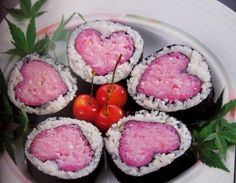 these sushis look awesome. also, note the weed leaves surrounding them for garnish.