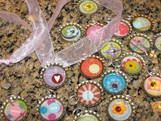 I just love they whimsy  and vividity  of these cute little Bottle Cap Charms.   I found an old box of bottle caps at a garage sale for a wh...