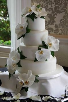Wedding Cake Dressed with Phalaenopsis Orchids, but instead with my bouquet flowers!