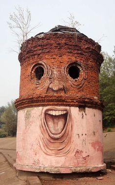 A street artist makes derelict structures come alive by adding eyes and facial features. Nikita Nomerz's work ranges from water towers painted to look like they're laughing to dilapidated buildings with broken window frames for eyes. Nomerz, from the western Russian city of Nizhniy Novgorod, travels around various cities in his homeland to carry out his art. The Big Brother, in Nizhniy Novgorod - Picture: Nikita Nomerz/Rex Features