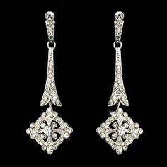 Silver art deco chandelier earrings encrusted with sparkling crystals are a lovely elegant statement on any occasion. The perfect accessory for elegant occasions or any special event.