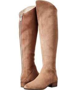 Make a standout statement in the dolce vita Meris Over The Knee Boot. - Nubuck leather upper in a dress over the knee boot style - Almond toe - Full length back zip closure - Asymmetrical collar - Tex