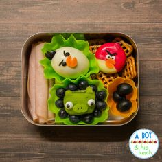 Angry Birds #bento  Smoked turkey rolls  Hard boiled egg  Blueberries & 1/2 of of kiwi  Black olives  Babybel cheese  Pretzel squares