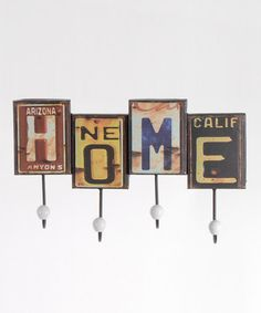 Take a look at this 'Home' License Plate Wall Hook by Lynn Roberts International on #zulily today!