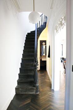 Julio did the floors and stairs himself — all the wood is seared white oak in a chevron pattern.