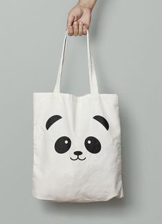 Everyone loves Pandas! Natural Color Cotton Canvas Tote Bags. These bags are 100% Cotton Canvas and are 15x16. This bag is perfect for groceries, goodies or even use as a gift bag for a fellow panda lover! Imprinted with black vinyl letters.