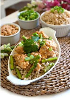 Chicken with Coconut-Lime Peanut sauce and asparagus.