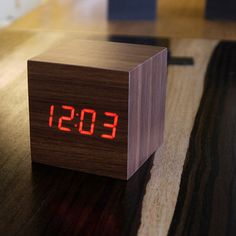 This tabletop cube is an innovative, eco-friendly wooden alarm clock that lights up with the time, date, and temperature. Gently tap your bedside table to trigger the LED display; you'll never have to scramble for your smartphone again. It's an ex...