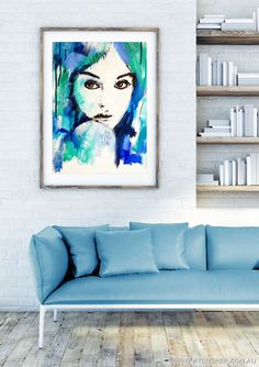 """""""It's A Man's World"""" (blue) artwork. Original colourful blue and green abstract female portrait painting on canvas by Australian artist Kate Fisher. Affordable wall art prints available. Styled framed artwork in modern living room."""